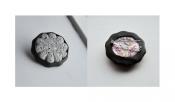 grijze bloem met steentjes en rubber